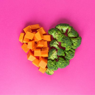 Pumpkin and broccoli on pink background