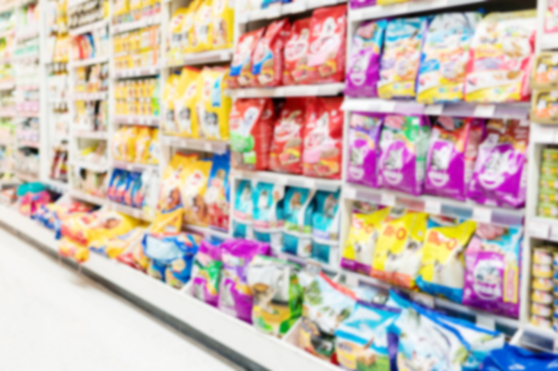 Blurry Background of Animal feed product department in supermarket.